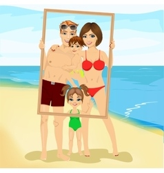 Smiling family looking through an empty frame vector image