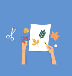 female hands a scrap booking on blue background vector image