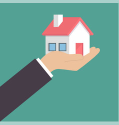 real estate offer businessman holding a house vector image