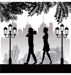 silhouette man radio and woman walking park twon vector image