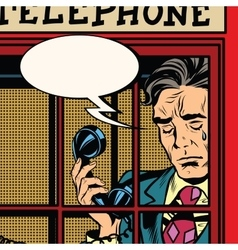 Retro man crying in the red phone booth vector