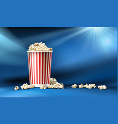 Red and white cardboard bucket with popcorn vector