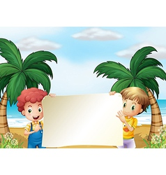 Two male kids holding an empty signboard vector image