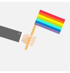 Businessman hand holding rainbow gay pride flag vector image