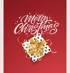 white lettering merry christmas on a red vector image