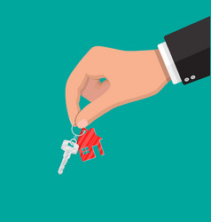 hand and metal key with keychain house vector image