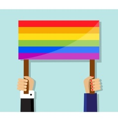 hand holding a gay pride flag vector image