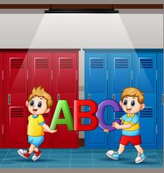 Cartoon boys holding alphabets in locker room vector