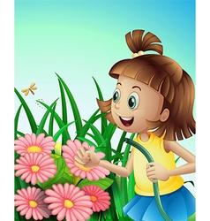 A girl with a hose at the garden vector