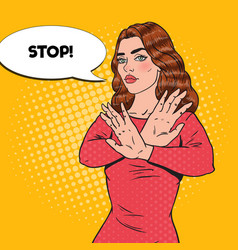 Pop art confident woman showing stop hand sign vector