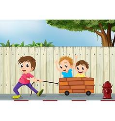Three boys playing near wooden wall vector