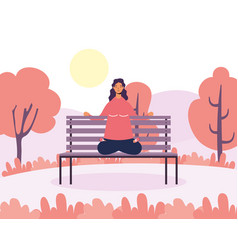 Young woman practicing yoga in park chair vector