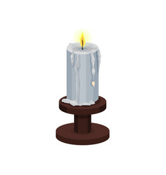 Burning candle with melting wax on small wooden vector
