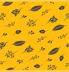 autumn leaves on a yellow background seamless patt vector image