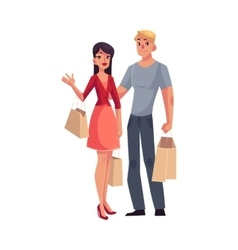 Couple of young man and woman with shopping bags vector image