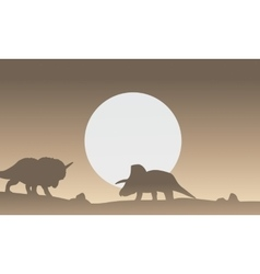 Silhouette of two triceratops dinosaur scenery vector image