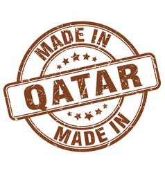 Made in qatar brown grunge round stamp vector
