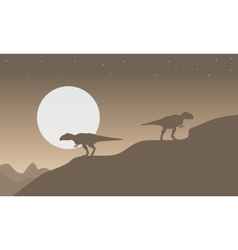 Silhouette of mapusaurus with big moon scenery vector