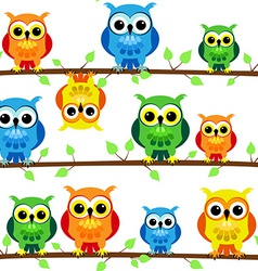 Seamless owls on tree branch vector