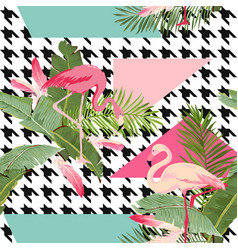 Seamless tropical flowers and flamingo pattern vector