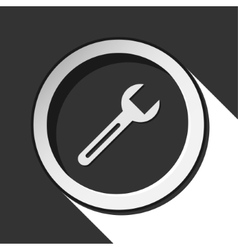 Dark gray icon with spanner vector