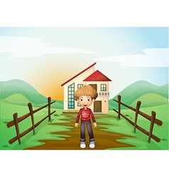 A boy in front of the concrete house vector