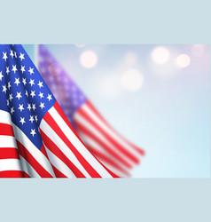 America flag waving against a clear blue sky vector