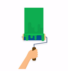 Hand holding roller brush and painting a wall vector