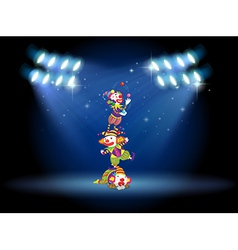 Three clowns performing on the stage with vector image