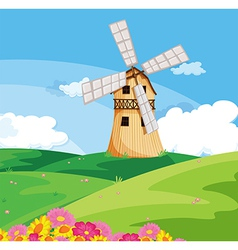 A windmill above hill vector