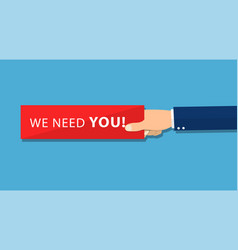 hand holding piece of paper with text we need you vector image