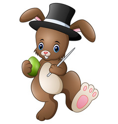 Cartoon rabbit magician wearing a hat with holding vector