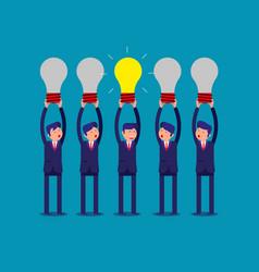 Businessman holding idea light bulbs above his vector