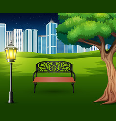 cartoon of chairs in green park with town building vector image