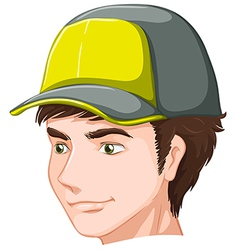 A boy wearing a cap vector