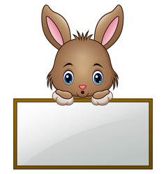 cartoon little bunny holding an empty sign vector image