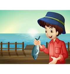Fisherman holding a fish vector