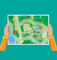folded paper city map in hands vector image