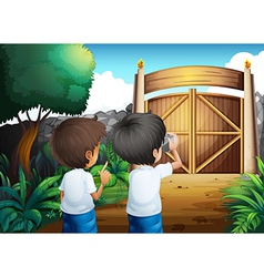 Boys taking pictures inside the gated yard vector image