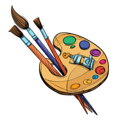 Artists palette with paints and brushes isolated vector