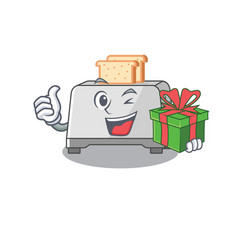 Happy bread toaster character having a gift box vector