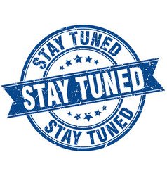 Stay tuned round grunge ribbon stamp vector