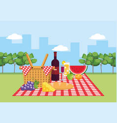 Basket with wine and fruits in the tablecloth vector
