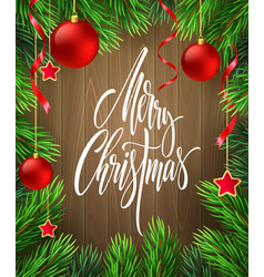 merry christmas lettering in fir branches frame vector image