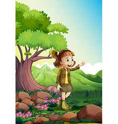 A female explorer at the rocky forest vector image