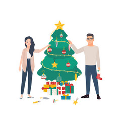 cute young couple decorating christmas tree vector image