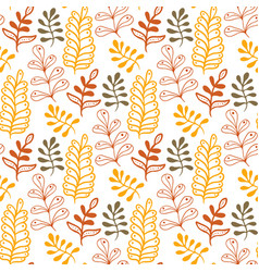 Hand-drawn leaves background in autumn colors vector