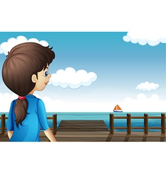 A girl watching the boat vector image