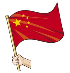 Hand holding China flag vector image vector image