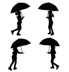 children with umbrella silhouette vector image